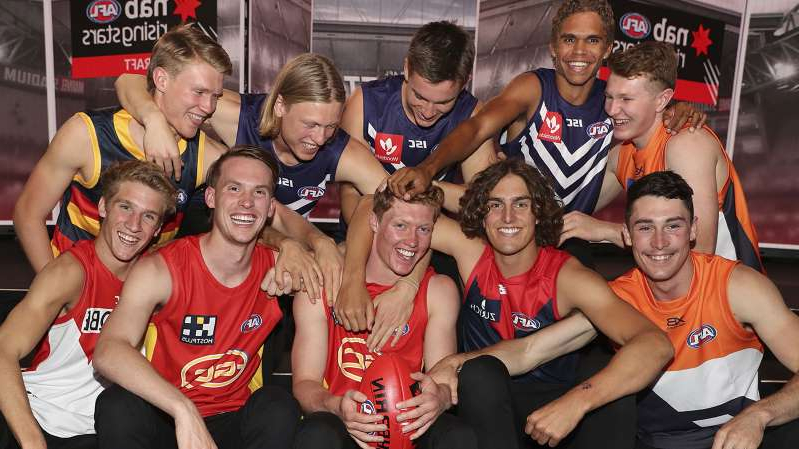 a group of people posing for the camera: 2019 AFL Draft