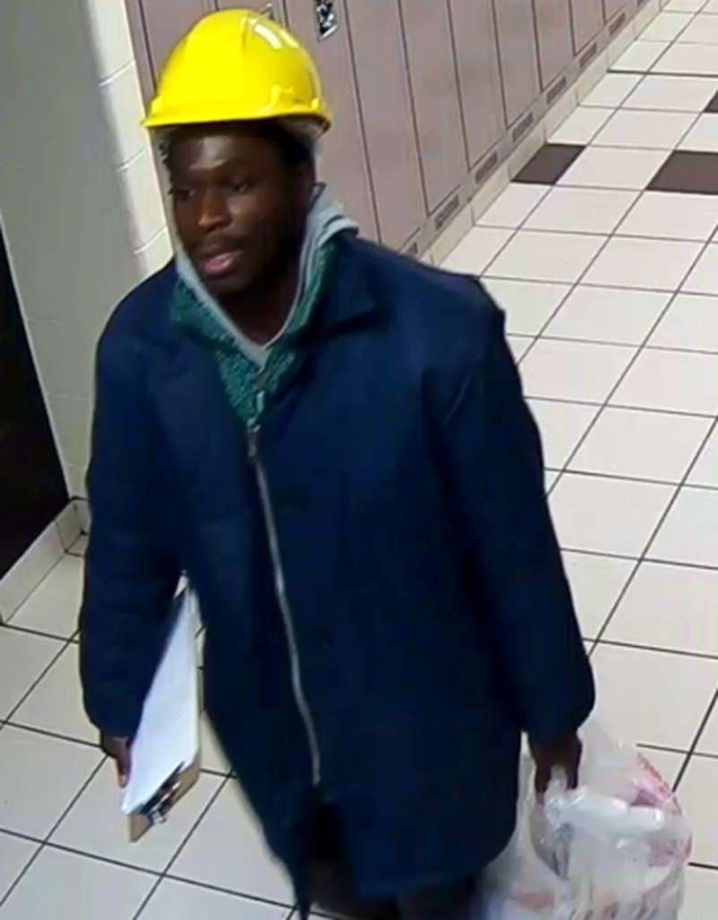 A man accused of tossing fecal matter on five people is due in court today. Samuel Opoku is charged with five counts of assault with a weapon and five counts of mischief. A man, wearing a hard hat and blue work jacket, carries a bucket through a hallway in an undated handout photo.