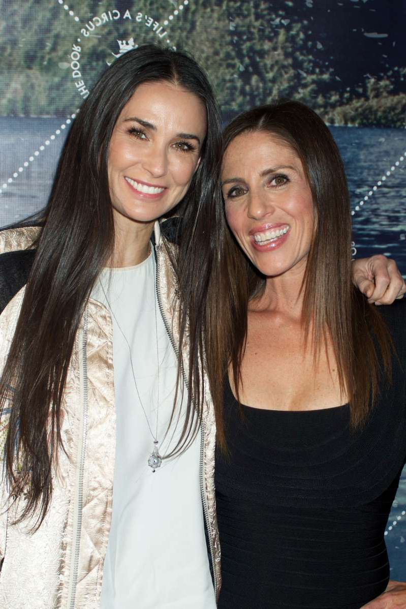 Demi Moore et al. posing for the camera: Soleil Moon Frye and Demi Moore attend the unveiling of Seedling's Arts District headquarters on May 28, 2015 in Los Angeles, Calif. (Photo: Keipher McKennie/WireImage)