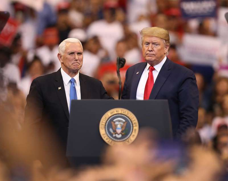 Donald Trump, Mike Pence are posing for a picture: President  Trump and Vice President Mike Pence stand together during a homecoming campaign rally at the BB&T Center on Nov. 26, 2019, in Sunrise, Fla.