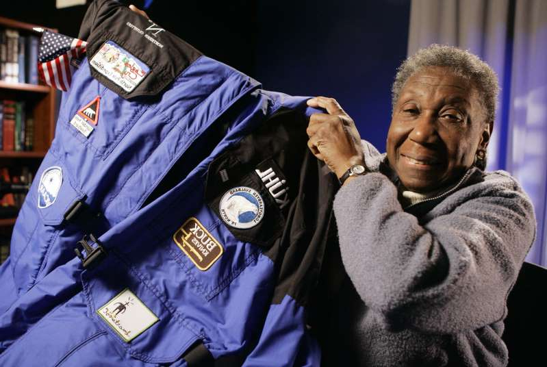 "FILE - In this May 3, 2007 file photo Barbara Hillary, 75, shows the parka she wore on her trip to the North Pole, as she is interviewed in New York. Hillary, who was in her 70s when she became the first black woman to officially make it to the North and South Poles, has died at 88. Her death was announced on Saturday, Nov.  23, 2019 on her Twitter account, which said she had gone through ""significant health decline in recent months."" It was also announced on her website. (AP Photo/Richard Drew, file)"