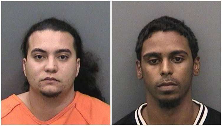 a group of people posing for the camera: Anthony Andrade  and Kevin Ramirez, both 24 years old, were arrested for a carjacking in Hillsborough County. Isabella Vivian Perez, the third suspect, is still at-large. Hillsborough County Sheriff's Office