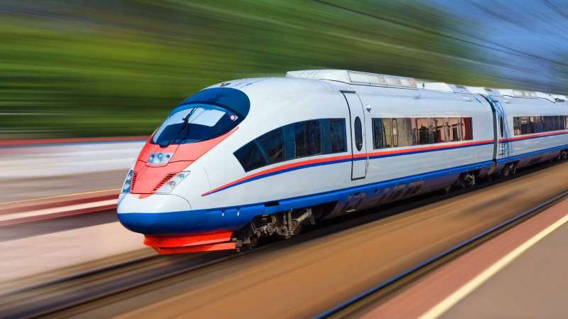 a red white and blue train on a track: High-Speed Train