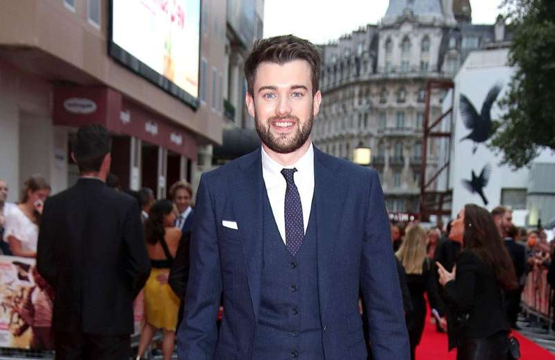 Jack Whitehall wearing a suit and tie