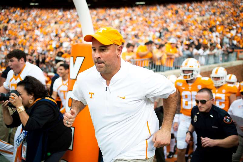 Jeremy Pruitt standing in front of a crowd: Tennessee Head Coach Jeremy Pruitt takes the field during a game between Tennessee and South Carolina at Neyland Stadium in Knoxville, Tennessee on Saturday, October 26, 2019.