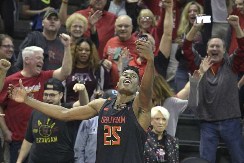 Maryland forward Jalen Smith (25) makes a selfie photo with fans after getting a win over Temple in an NCAA college basketball tournament game Thursday, Nov. 28, 2019, in Lake Buena Vista, Fla. (AP Photo/Phelan M. Ebenhack)