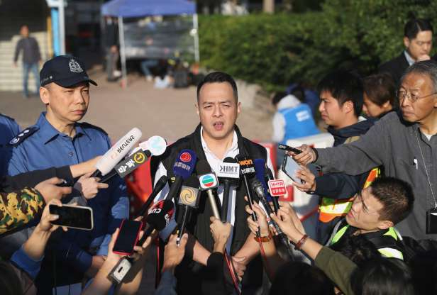Slide 4 of 62: A Hong Kong police spokesperson holds a news conference in front of the Hong Kong Polytechnic University (PolyU) in Hong Kong, China, November 28, 2019.