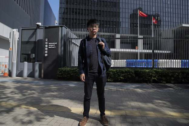 Slide 5 of 62: Pro-democracy activist Joshua Wong stands outside the Legislative Council building in Hong Kong, Thursday, Nov. 28, 2019. Police teams on Thursday began clearing a Hong Kong university that was a flashpoint for clashes with anti-government demonstrators, as the government slammed a U.S. move to sign into law bills supporting human rights in the Chinese territory.