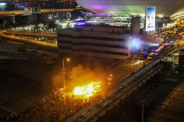 Slide 53 of 62: Fire erupts as pro-democracy protesters clash with police on a bridge outside the Hong Kong Polytechnic University (PolyU), in Hong Kong, China, 17 November 2019. Hong Kong is in its sixth month of mass protests, which were originally triggered by a now withdrawn extradition bill and have since turned into a wider pro-democracy movement. Protests in Hong Kong, China - 17 Nov 2019