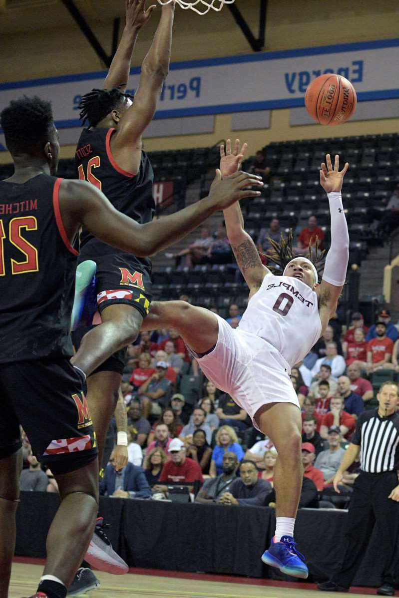 Temple guard Alani Moore II (0) is fouled by Maryland forward Donta Scott (24), while going up for a shot, as forward Makhi Mitchell (21) watches during the first half of an NCAA college basketball tournament game Thursday, Nov. 28, 2019, in Lake Buena Vista, Fla. (AP Photo/Phelan M. Ebenhack)