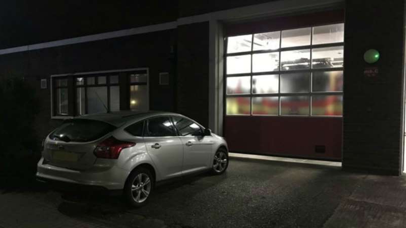 a car parked in front of a building: The car was parked outside the door to the fire station (Hampshire Fire and Rescue/PA)