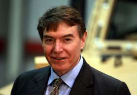 Philip Dunne wearing a suit and tie: Tory candidate Philip Dunne