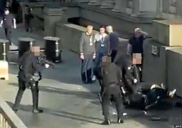 a group of people in a room: Up to five people were stabbed before the knife maniac ran onto London Bridge shortly before 2pm this afternoon, where dramatic video (pictured above) showed he was tackled to the ground by at least six heroic members of the public