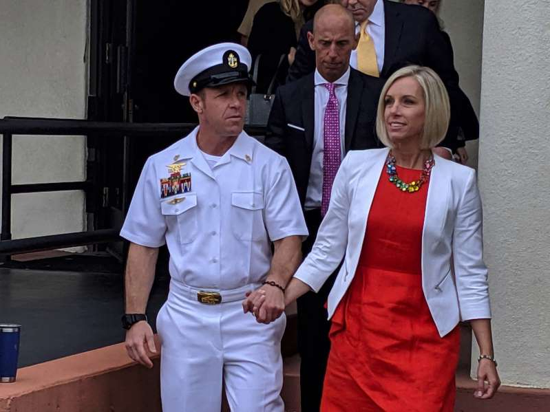 a group of people posing for the camera: Navy Special Operations Chief Edward Gallagher leaves a military courtroom on Naval Base San Diego with his wife, Andrea Gallagher.