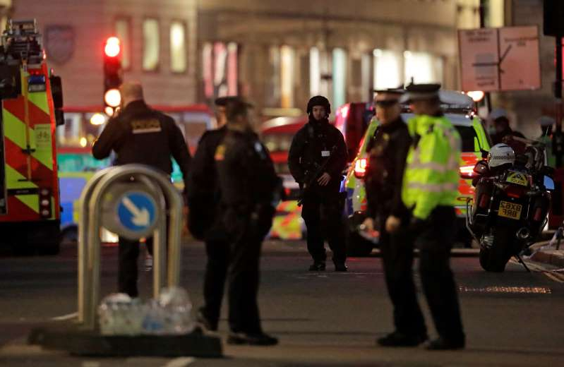 Armed police officers on the north side of London Bridge in London, Friday, Nov. 29, 2019. British police shot a man on London Bridge in the heart of Britain's capital on Friday after a stabbing that left several people wounded. The Metropolitan Police force said the circumstances were still unclear, but