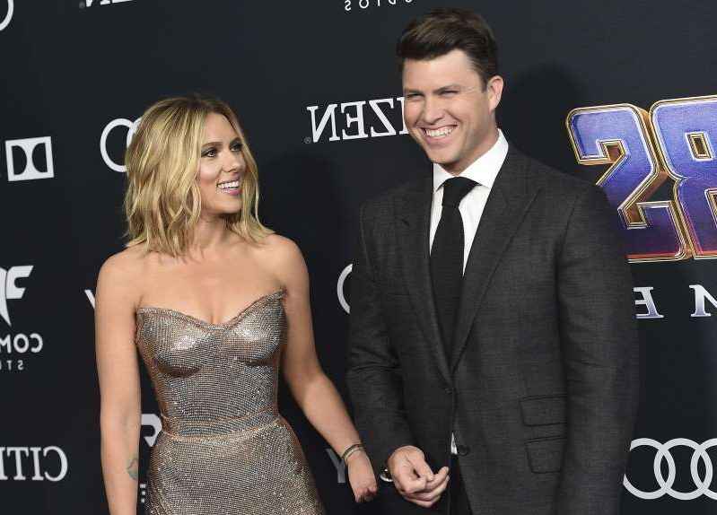 FILE - In this April 22, 2019, file photo, Colin Jost, left, and Scarlett Johansson arrive at the premiere of
