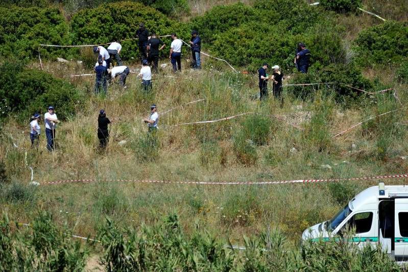 British police and their Portuguese counterparts investigating the disappearance of Madeleine McCann seven years ago from Praia da Luz on the Algarve, in Portugal during a search of a patch of scrubland just outside of the small coastal town as the search for clues enters a second week.   (Photo by Nick Ansell/PA Images via Getty Images)