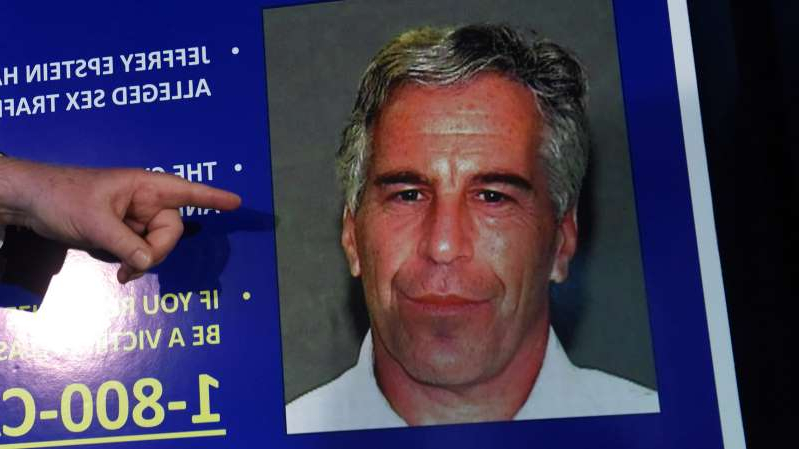 Jeffrey Epstein holding a sign: In July, the United States attorney for the Southern District of New York announced charges against Mr. Epstein.