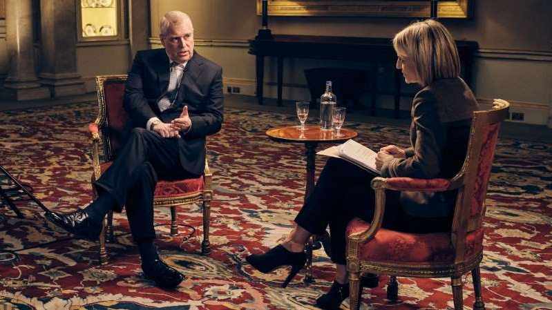 Prince Andrew, Duke of York et al. sitting in a chair: Prince Andrew during the BBC interview that many branded a 'train wreck'.