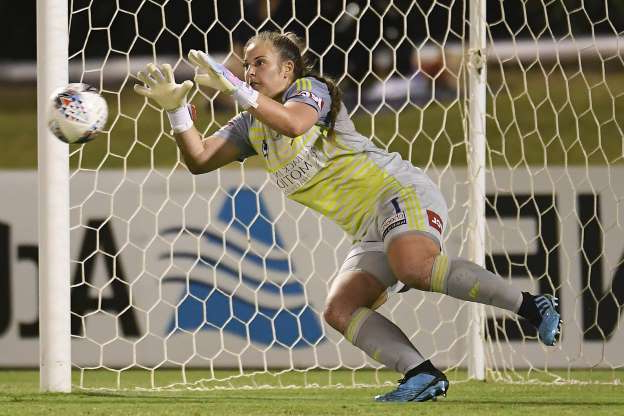 Slide 6 of 50: BRISBANE, AUSTRALIA - NOVEMBER 21: Casey Dumont of the Victory blocks a penalty kick from Tameka Yallop of the Roar during the round two W-League match the between Brisbane Roar and the Melbourne Victory at Dolphin Stadium on November 21, 2019 in Brisbane, Australia. (Photo by Albert Perez/Getty Images)