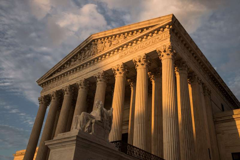 a large white building: The Supreme Court will hear oral arguments Monday in a case challenging a law that limits where New Yorkers can carry guns. (J. Scott Applewhite/AP)
