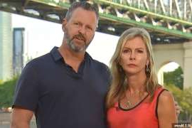 a man and a woman standing in front of a building: Sara's mother and stepfather Julie and Mark Wallace were devastated to hear about another deadly terror attack on London Bridge, where Sara was killed two years ago