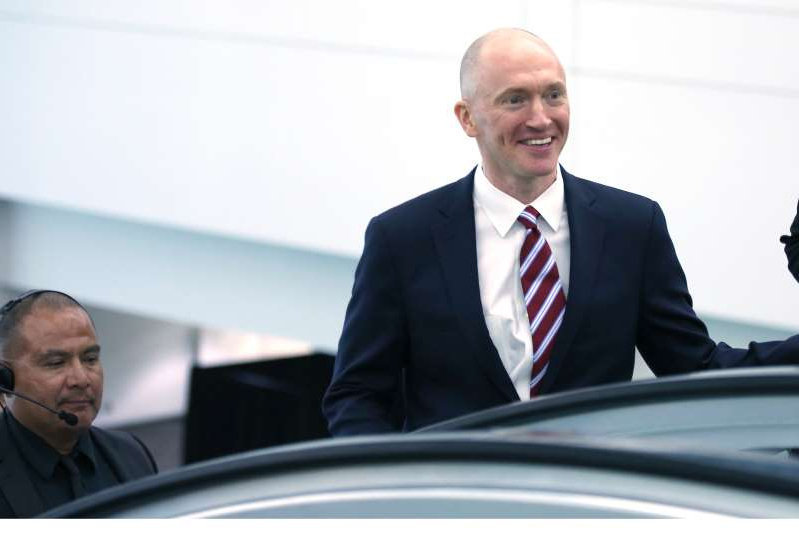 a man wearing a suit and tie: Carter Page.