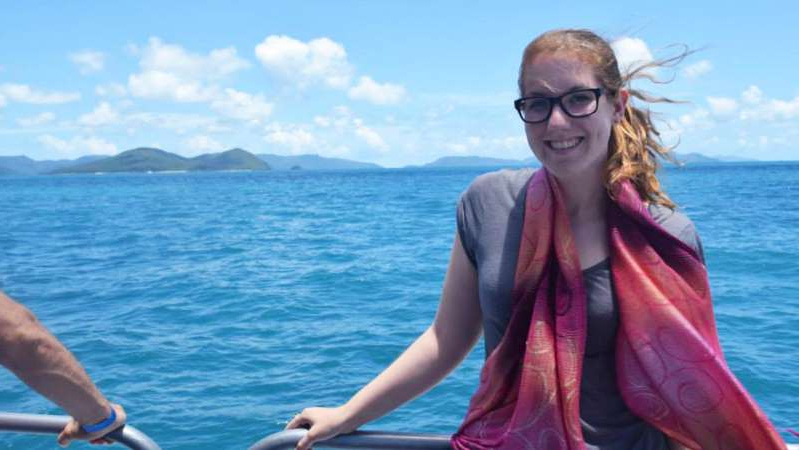 a person standing in front of a body of water: Holidays to the beach can be stressful for Alexandra Geelan because of her phobia of fish. (Supplied: Alexandra Geelan)