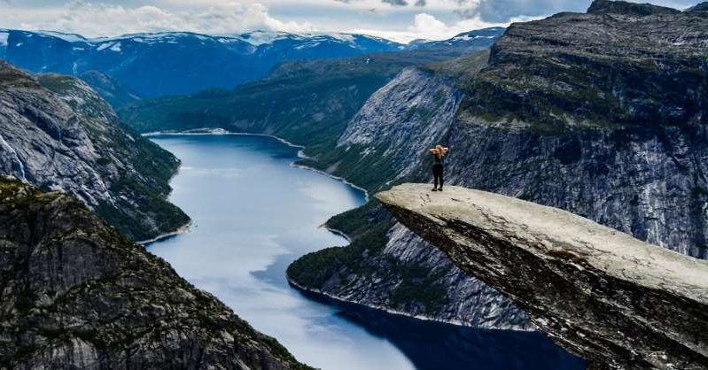 a small island in the middle of a rocky mountain: Ten years ago, Norway's Trolltunga received around 800 visitors in a year; during high season, twice that now come in a single day.