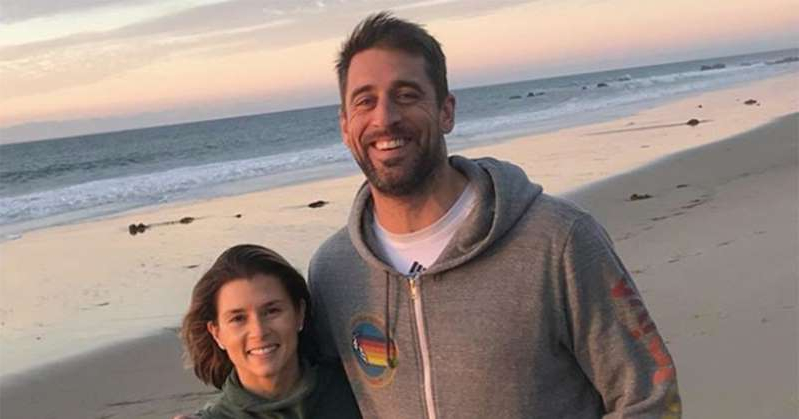 Aaron Rodgers, Danica Patrick are posing for a picture: Danica Patrick Wishes 'Uber Attractive' Aaron Rodgers a Happy Birthday: 'I Am So Grateful'