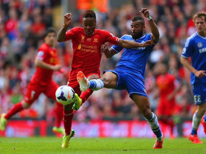 Ashley Cole, Raheem Sterling playing football on a field: Ashley Cole of Chelsea and Raheem Sterling of Liverpool