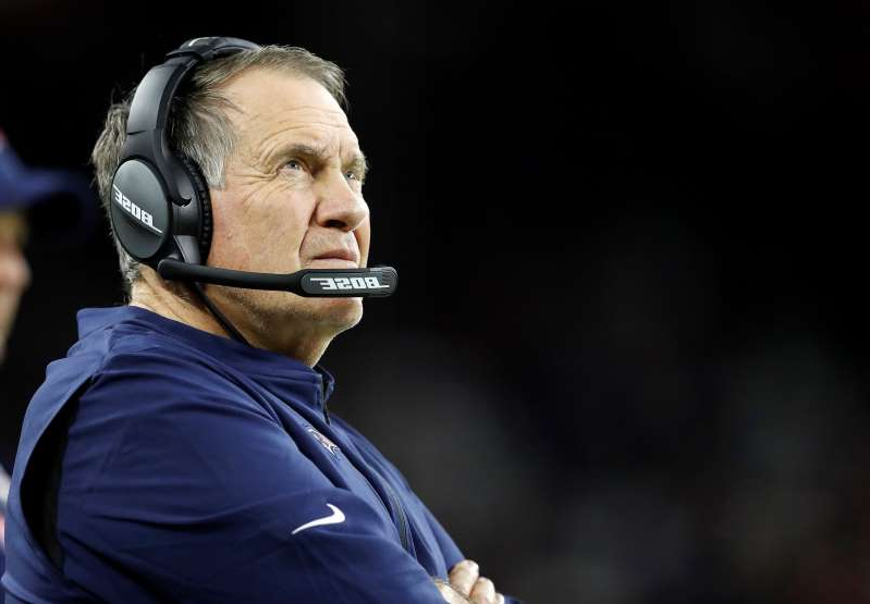 Bill Belichick wearing a mask: Patriots coach Bill Belichick wasn't happy after Sunday's loss. (Photo by Tim Warner/Getty Images)