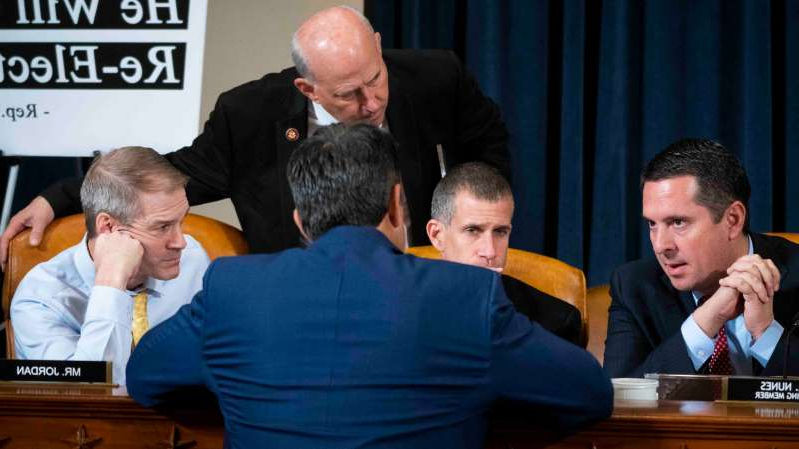 Devin Nunes et al. sitting at a table: Representative Devin Nunes, left, the ranking member on the Intelligence Committee, speaking to other Republicans last month during an impeachment inquiry hearing.