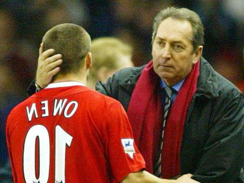 Gerard Houllier wearing a red shirt: Despite having Michael Owen leading the line, Gerard Houllier was unable to bring the title to Anfield in 2002/03