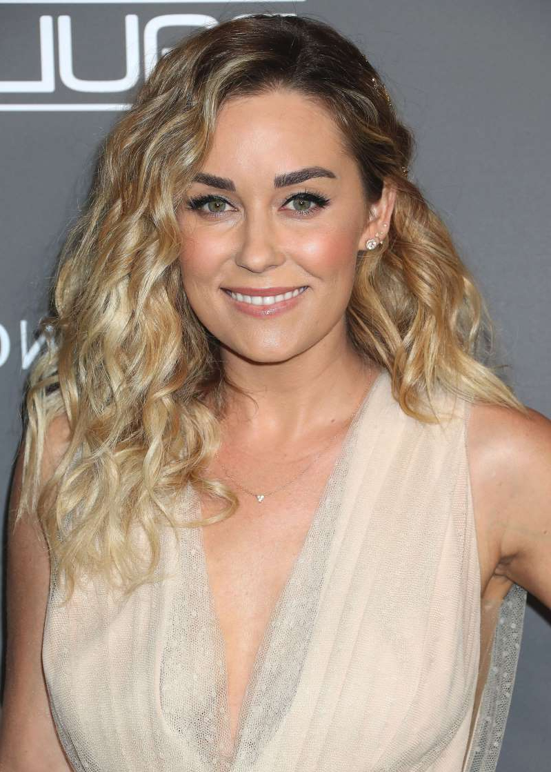 Lauren Conrad smiling for the camera: Lauren Conrad attends the Baby2Baby gala in Los Angeles on Nov. 10, 2018.