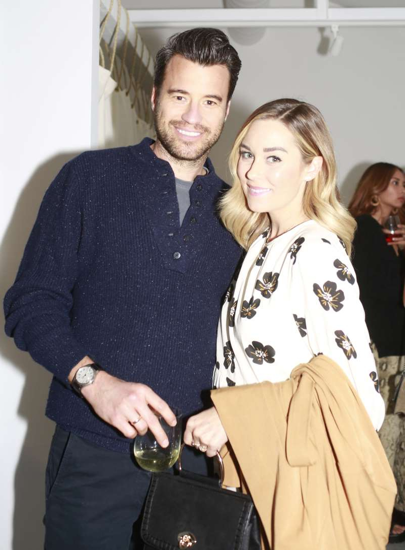 Lauren Conrad, William Tell posing for the camera: Lauren Conrad and husband William Tell attend a party for fine art photographer Gray Malin's Beaches collection with Kim Crawford wines at Bollare's Beach Bungalow in Newport Beach, California, on March 19, 2019.