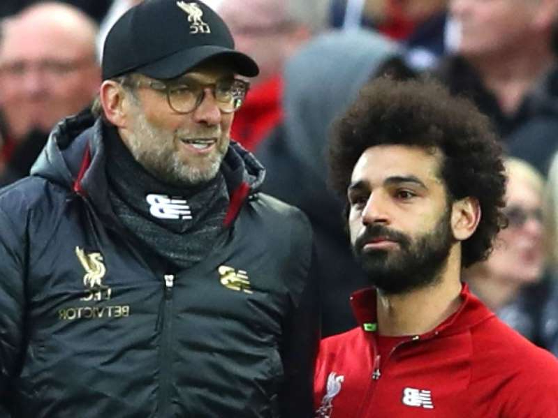 Mohamed Salah standing in front of a crowd: Jurgen Klopp and Mohamed Salah suffered Premier League heartbreak in 2018/19