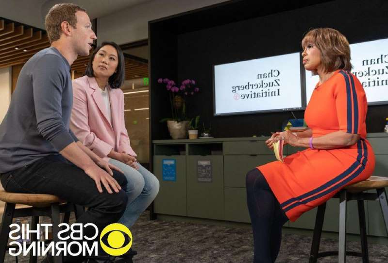 Priscilla Chan et al. sitting on a bench: Mark Zuckerberg and Priscilla Chan talked with CBS This Morning about the Chan Zuckerberg Initiative and challenges facing Facebook. CBS News