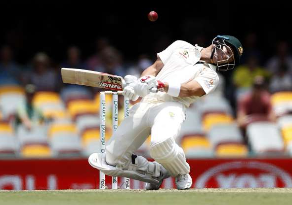 Slide 11 of 50: BRISBANE, AUSTRALIA - NOVEMBER 22: David Warner of Australia avoids a short ball from Naseem Shah of Pakistan during day two of the 1st Domain Test between Australia and Pakistan at The Gabba on November 22, 2019 in Brisbane, Australia. (Photo by Ryan Pierse/Getty Images)