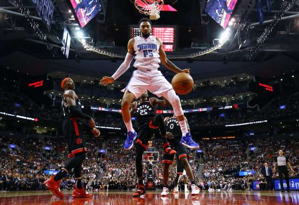 Slide 14 of 50: TORONTO, ON - NOVEMBER 20:  Khem Birch #24 of the Orlando Magic dunks the ball during the second half of an NBA game against the Toronto Raptors at Scotiabank Arena on November 20, 2019 in Toronto, Canada.  NOTE TO USER: User expressly acknowledges and agrees that, by downloading and or using this photograph, User is consenting to the terms and conditions of the Getty Images License Agreement.  (Photo by Vaughn Ridley/Getty Images)
