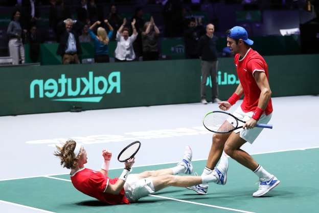 Slide 18 of 50: MADRID, SPAIN - NOVEMBER 22: Andrey Rublev of Russia and team mate Karen Khachanov celebrate winning match point in their quarter final doubles match against Serbia on Day Five of the 2019 Davis Cup at La Caja Magica on November 22, 2019 in Madrid, Spain. (Photo by Alex Pantling/Getty Images)