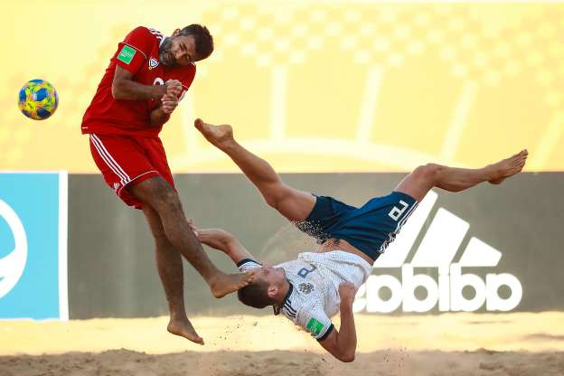 Slide 2 of 50: ASUNCION, PARAGUAY - NOVEMBER 24: Boris Nikonorov of Russia struggles for the ball with Haitham Mohamed of United Arab Emirates during the FIFA Beach Soccer World Cup Paraguay 2019 group C match between Russia and United Arab Emirates at Estadio Mundialista