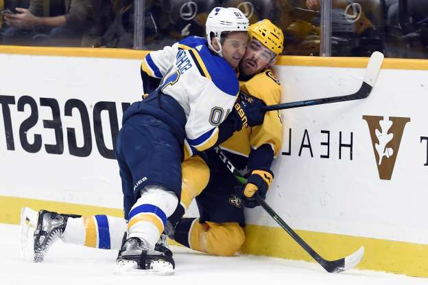 Slide 21 of 50: St. Louis Blues center Brayden Schenn (10) checks Nashville Predators defenseman Dante Fabbro (57) into the boards during the first period of an NHL hockey game Monday, Nov. 25, 2019, in Nashville, Tenn. (AP Photo/Mark Zaleski)