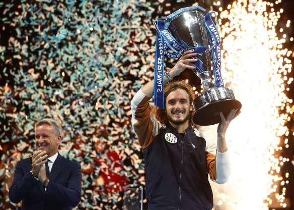 Slide 24 of 50: LONDON, ENGLAND - NOVEMBER 17: Stefanos Tsitsipas of Greece lifts the trophy after his singles final match victory against Dominic Thiem of Austria during Day Eight of the Nitto ATP World Tour Finals at The O2 Arena on November 17, 2019 in London, England. (Photo by Julian Finney/Getty Images)