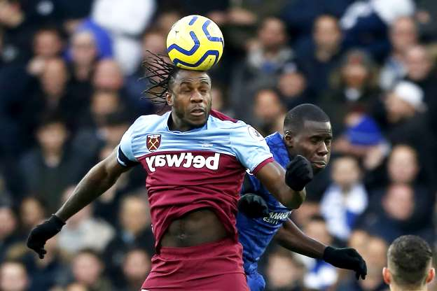 Slide 24 of 75: West Ham United's English midfielder Michail Antonio heads the ball during the English Premier League football match between Chelsea and West Ham United at Stamford Bridge in London on November 30, 2019.