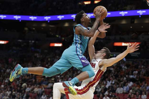 Slide 26 of 50: Charlotte Hornets guard Malik Monk, right, is fouled by Miami Heat forward Duncan Robinson during the first half of an NBA basketball game, Monday, Nov. 25, 2019, in Miami. (AP Photo/Lynne Sladky)