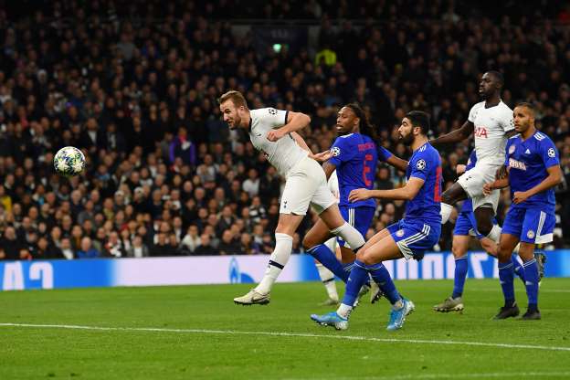 Slide 31 of 50: LONDON, ENGLAND - NOVEMBER 26: Harry Kane of Tottenham Hotspur scores his team's fourth goal during the UEFA Champions League group B match between Tottenham Hotspur and Olympiacos FC at Tottenham Hotspur Stadium on November 26, 2019 in London, United Kingdom. (Photo by Justin Setterfield/Getty Images)