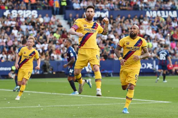 Slide 35 of 50: VALENCIA, SPAIN - NOVEMBER 02: Lionel Messi of FC Barcelona celebrates after scoring his team's first goal during the Liga match between Levante UD  and FC Barcelona at Ciutat de Valencia on November 02, 2019 in Valencia, Spain. (Photo by Alex Caparros/Getty Images)
