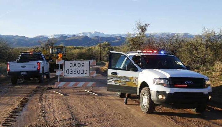 Slide 36 of 43: The road closed near Bar X road and Tonto Creek after a vehicle was washed by flood waters in Tonto Basin, Arizona on Nov. 30, 2019.