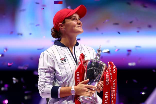 Slide 39 of 50: SHENZHEN, CHINA - NOVEMBER 03: Ashleigh Barty of Australia celebrates with the Billie Jean King trophy after her Women's Singles final match victory against Elina Svitolina of Ukraine on Day Eight of the 2019 Shiseido WTA Finals at Shenzhen Bay Sports Center on November 03, 2019 in Shenzhen, China. (Photo by Clive Brunskill/Getty Images)